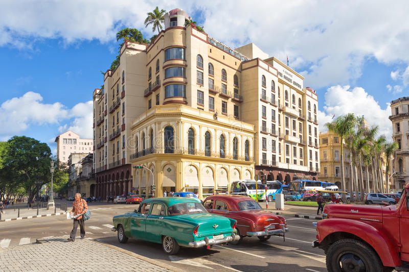 Old american cars near a modern hotel in Havana stock image