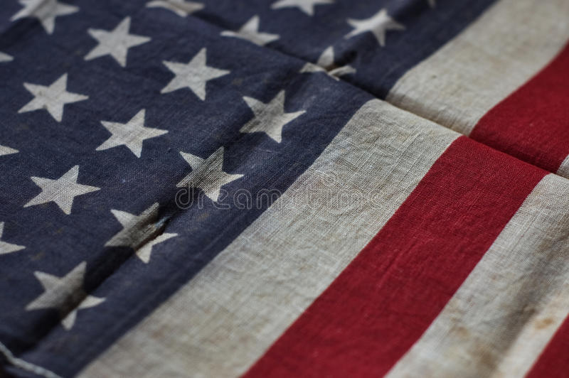 Old American flag. Close up of an old and worn American flag royalty free stock photo
