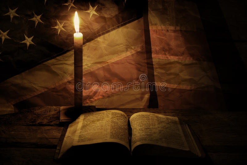 Old american flag and candle. Burning candle near a book. Wisdom comes with time. Learn the right things royalty free stock images