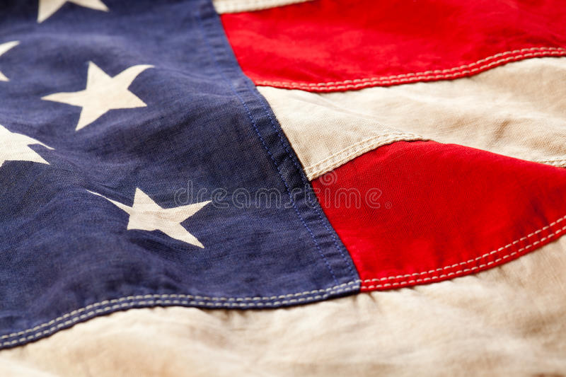 Old American flag detail. Close up of a vintage American flag royalty free stock photos