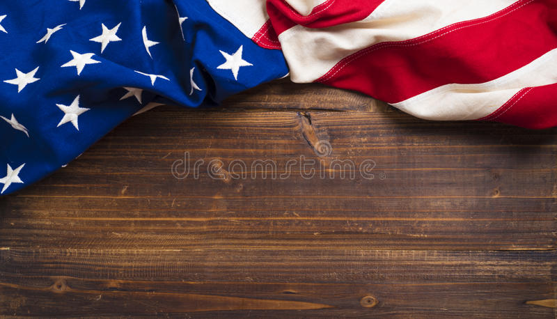 Old American Flag on wooden plank background royalty free stock photography