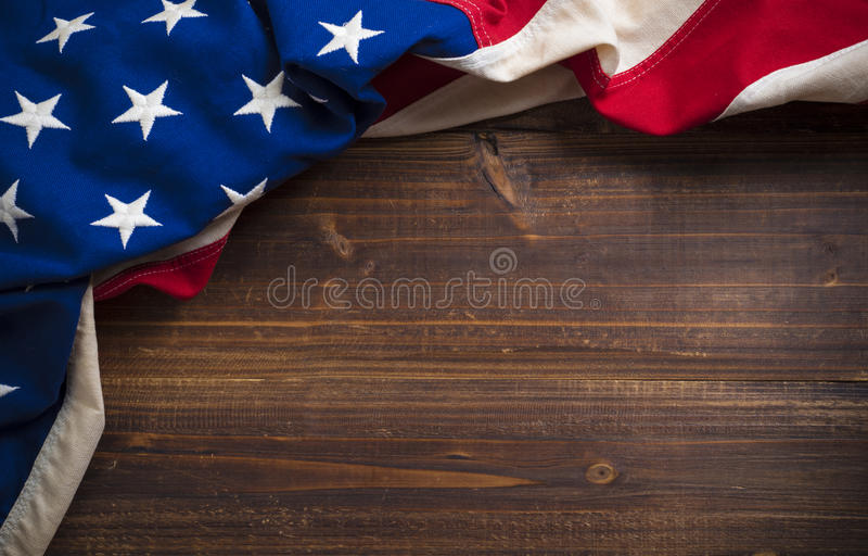 Old American Flag on wooden plank background stock photography