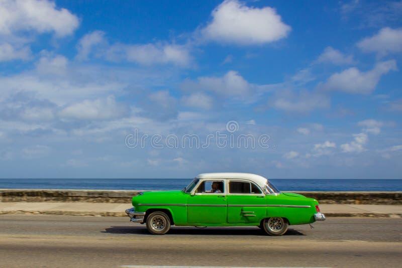Old American Green Car in Havana. Green Car driving along the Malecon, Havana stock photo