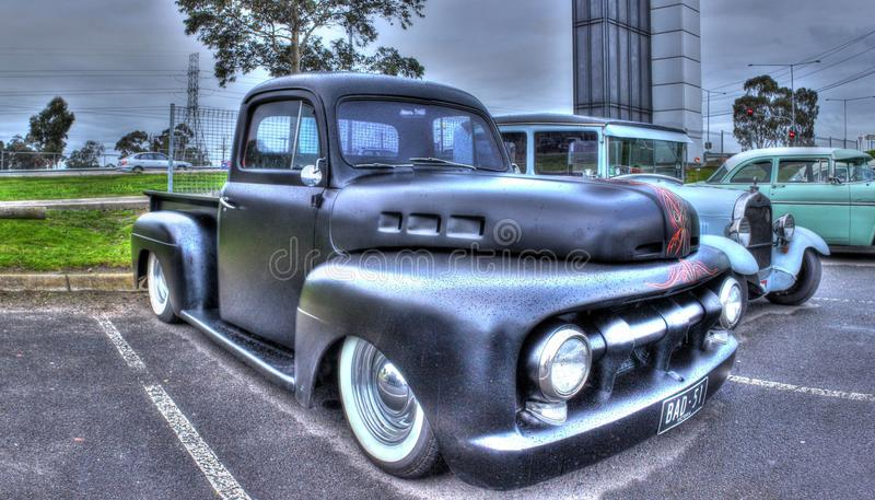 Old American pick up truck. Old American 1950s black pick-up truck with pin striping on display at car show in Melbourne, Australia royalty free stock image