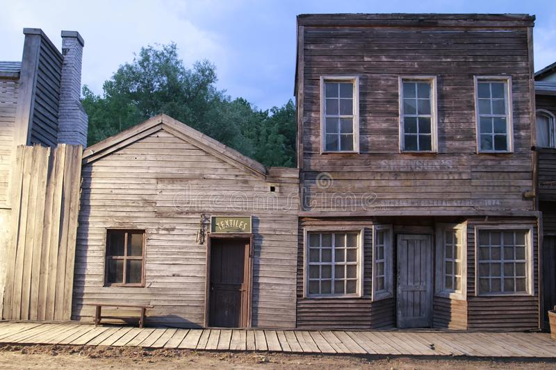 Old american western town front of houses stock photos