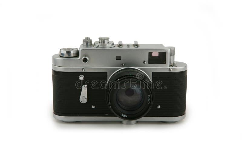 Old analog camera. Isolated on white stock image