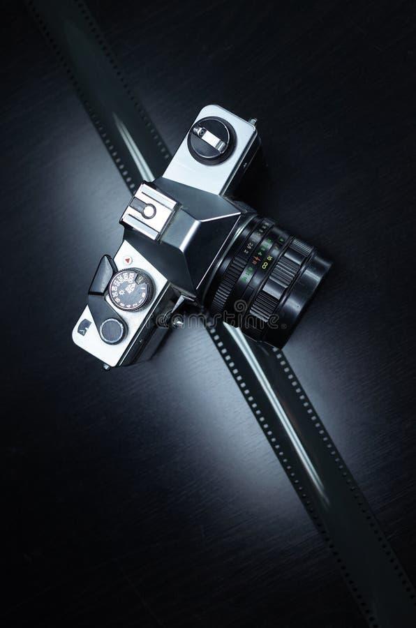 Old analog camera on black background royalty free stock photography