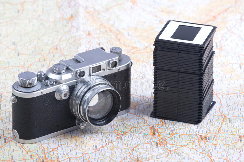 Old analog Camera and Stack of slides. Over map of Germany royalty free stock photo