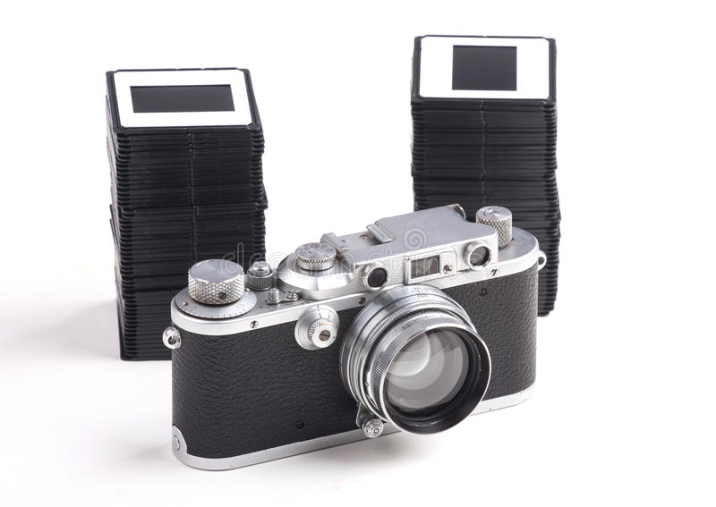 Old analog Camera and Stack of slides. Over white background stock photos