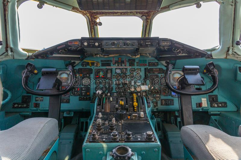 Old analog cockpit of an airliner airplane. With plenty of switches, levers and instruments stock photo