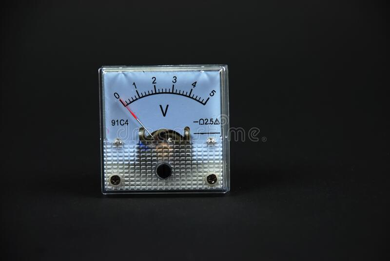 Old and analog current and voltage meters stock photos