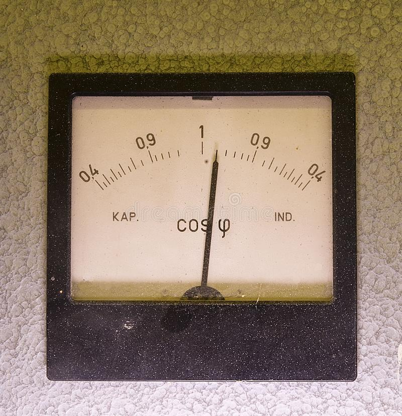 Old analog instrument- Power factor meter isolaated on grey background royalty free stock photos