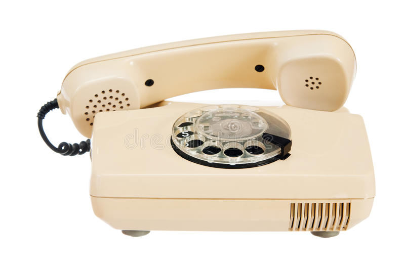 Old analog phone with a disk. It is isolated on white royalty free stock images