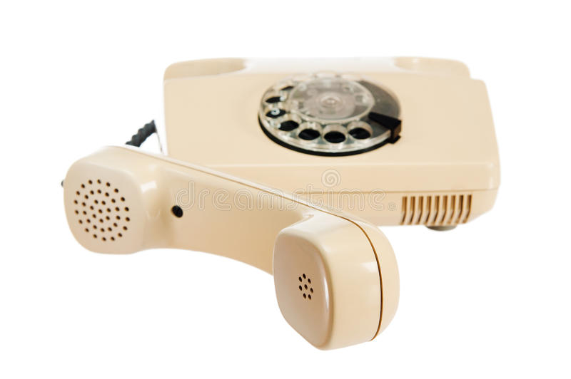 Old analog phone with a disk. It is isolated on white royalty free stock photo