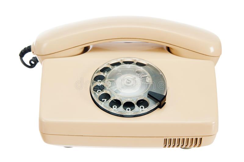 Old analog phone with a disk. It is isolated on white royalty free stock image