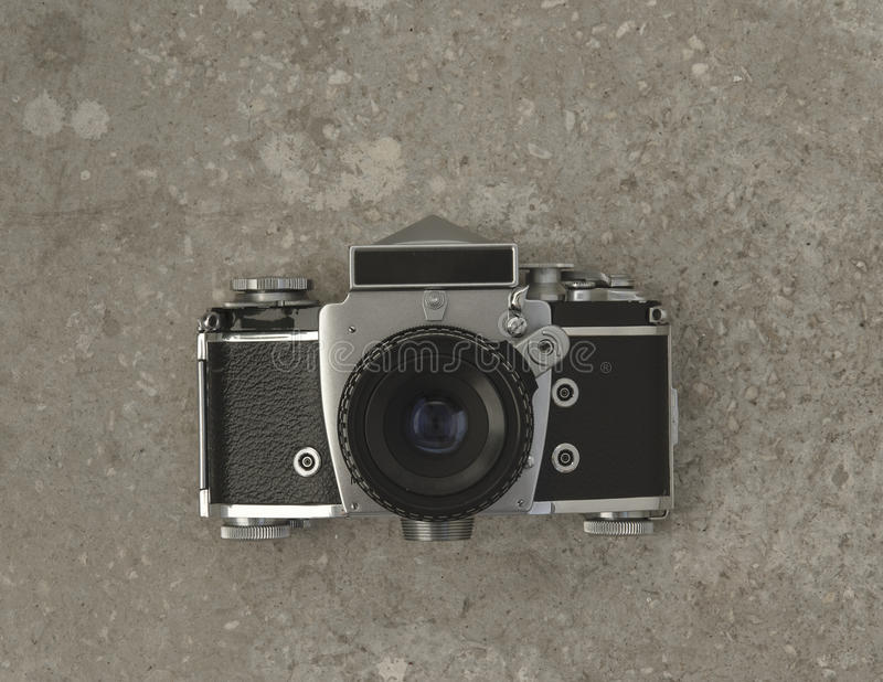 Old analog photo camera. On concrete background. Above view stock images