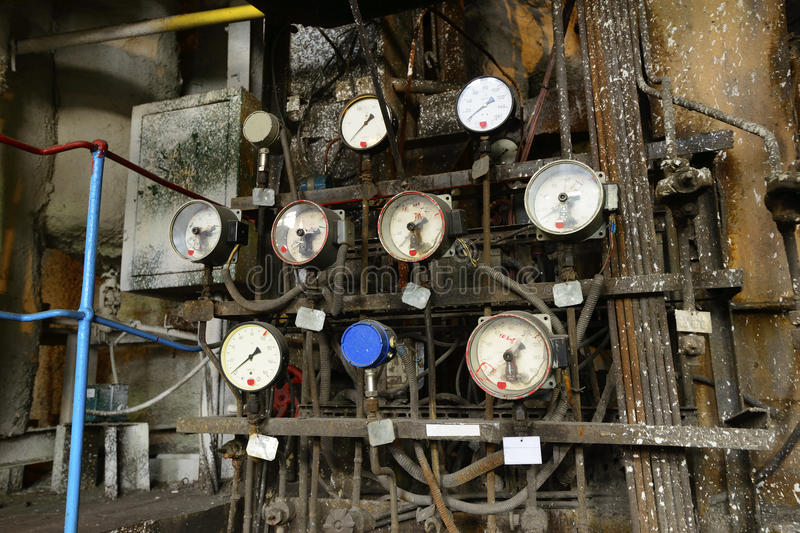 Old analog pressure meters in a power plant. Old analog pressure meters in a thermal power plant stock photos