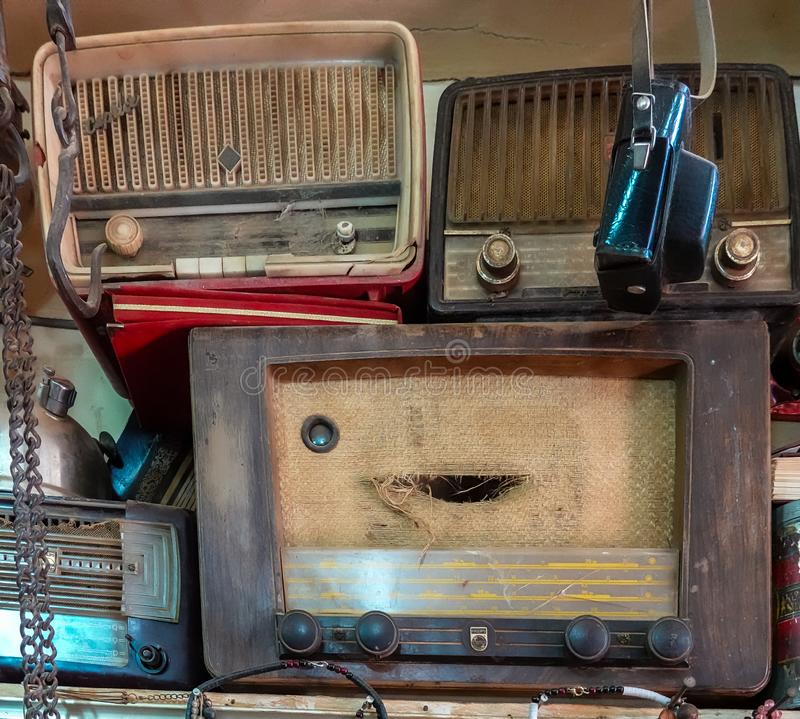 Old analog radios and an analog camera in a shop in the souk of Omdurman royalty free stock photo