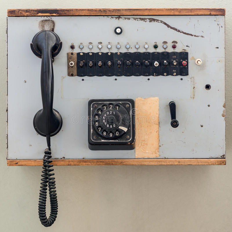 Old analog telephone cell with jog dial. In wooden box stock photo