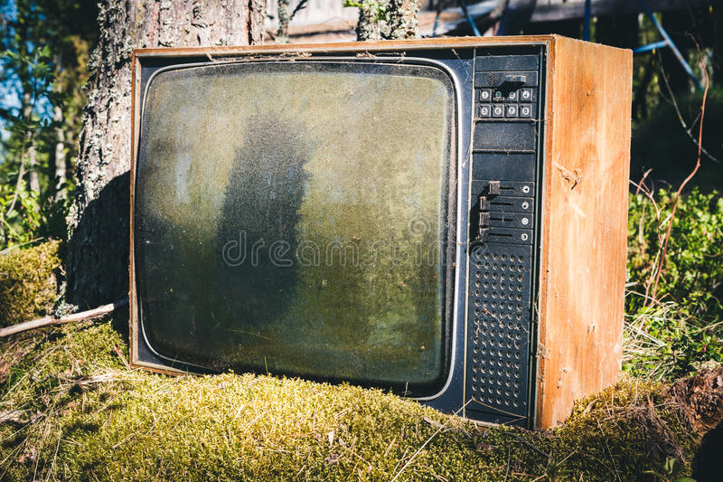 Old analog television in forest stock photos
