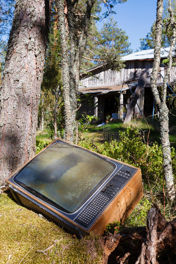 Old analog television in forest stock images