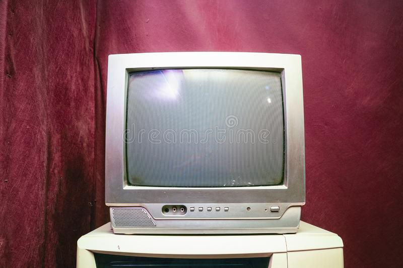 Old analog TV with kinescope. On a red background stock photos