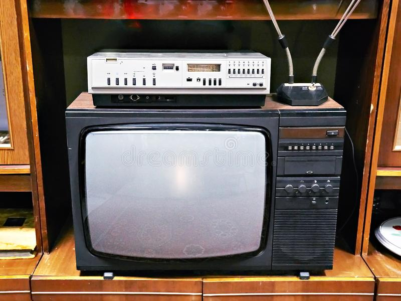 Old analog TV and VCR. In interior stock photos