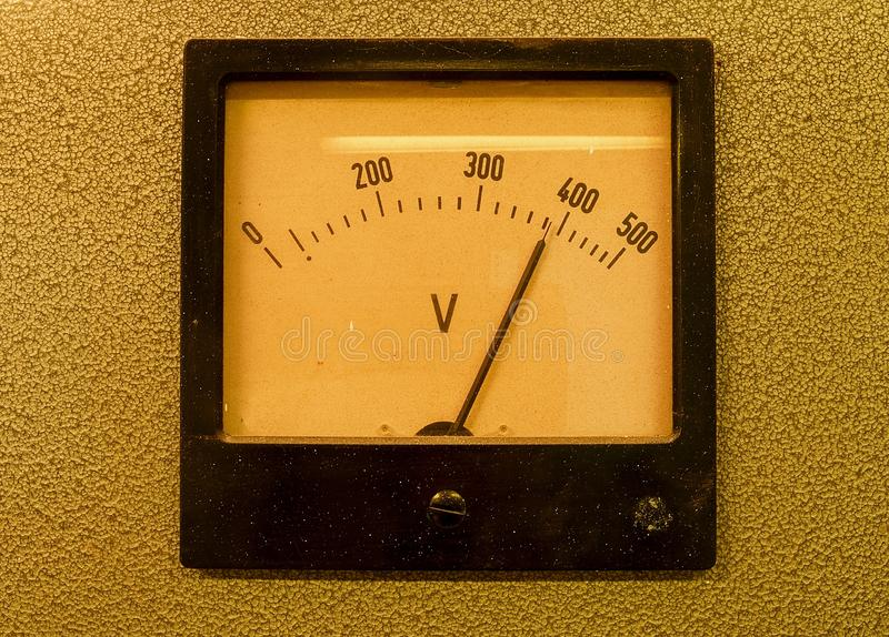 Old analog volt meter. Old measuring instrument with arrow and white scale stock images