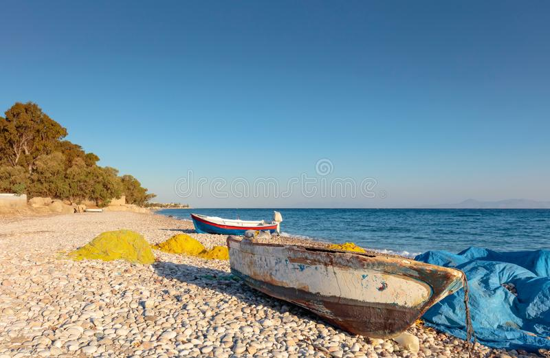 Old fishing boats on a beach of the Mediterranean Sea. royalty free stock photography