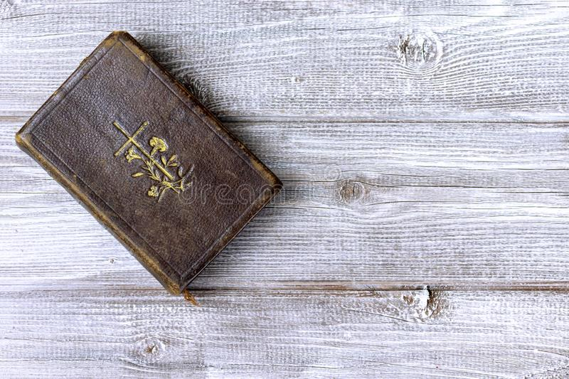 Old ancient antique catholic bible on wooden background with copy space.  royalty free stock photo