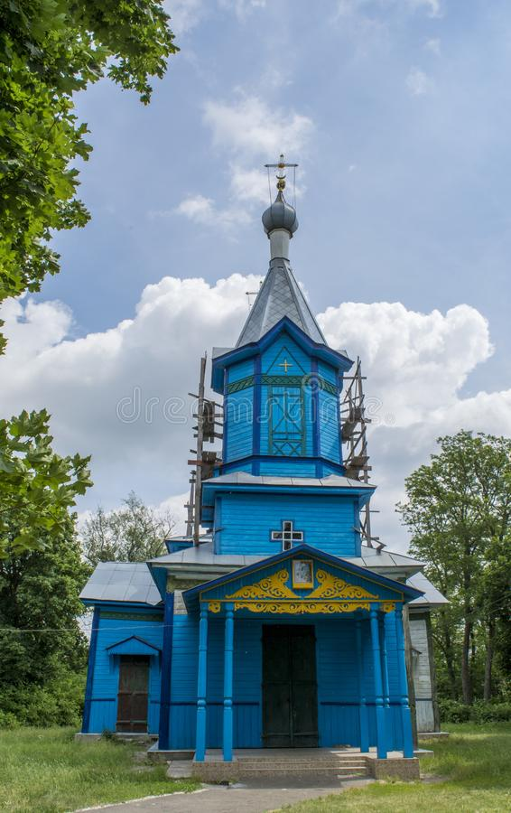 Old ancient blue christian church located in the village. In Ukraine royalty free stock images