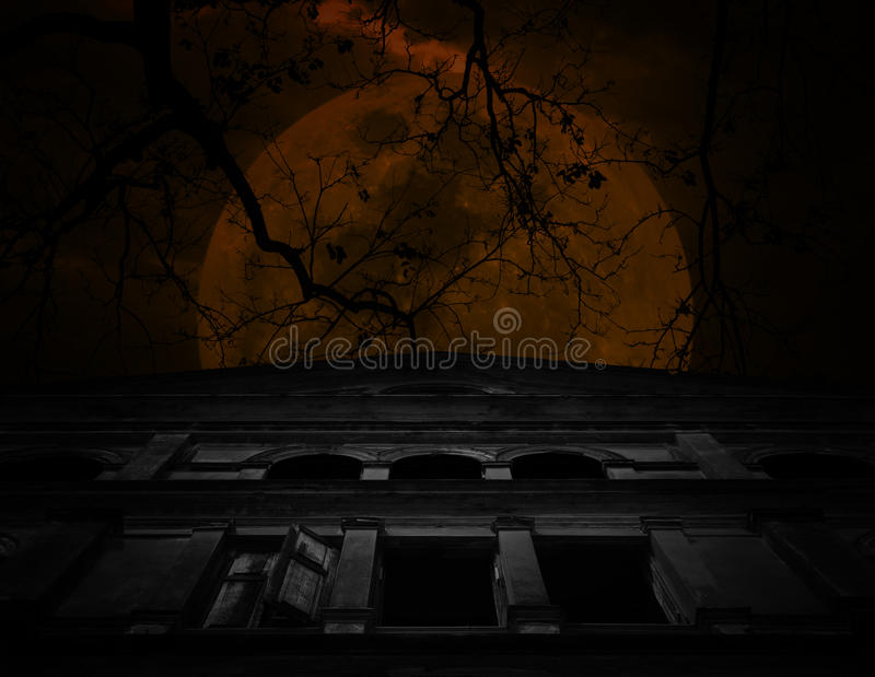 Old ancient castle with dead tree over moon and cloudy sky, Spooky background, Halloween concept royalty free stock photos