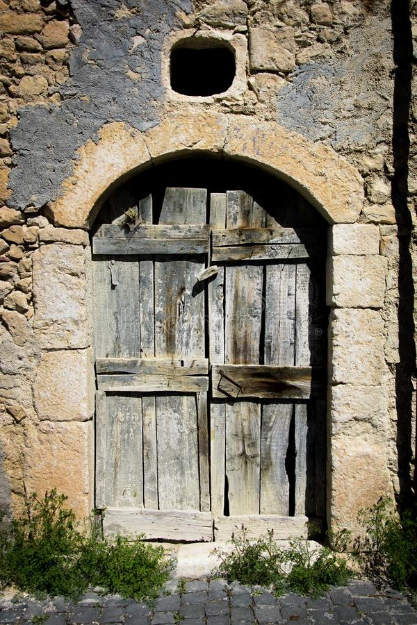 Old ancient house door in an Italian country royalty free stock images