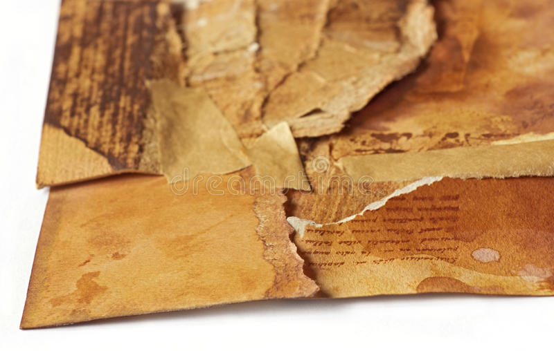 old ancient paper torn in pieces brought back together again, symbolic concept royalty free stock photography