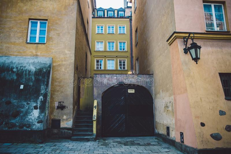 Old ancient polish architecture. Colorful houses as a part of center of the Warsaw. Castle with red bricks royalty free stock images