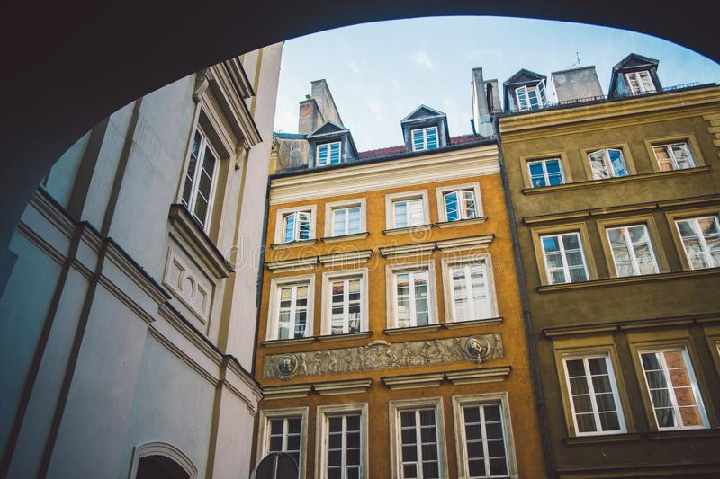 Old ancient polish architecture. Colorful houses as a part of center of the Warsaw. Castle with red bricks stock photo