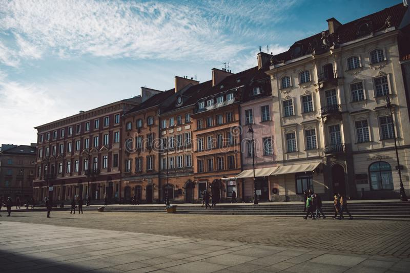 Old ancient polish architecture. Colorful houses as a part of center of the Warsaw. Castle with red bricks stock images