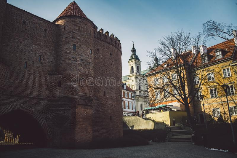 Old ancient polish architecture. Colorful houses as a part of center of the Warsaw. Castle with red bricks stock photography