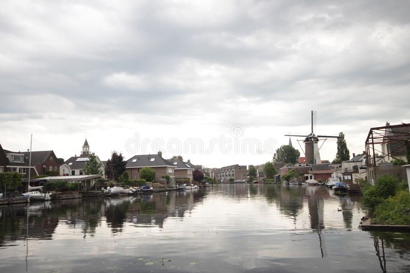 Old ancient windmill along river Old Rhine in city of Bodegraven whch became beer brewery. Old ancient windmill along river Old Rhine in city of Bodegraven whch stock image