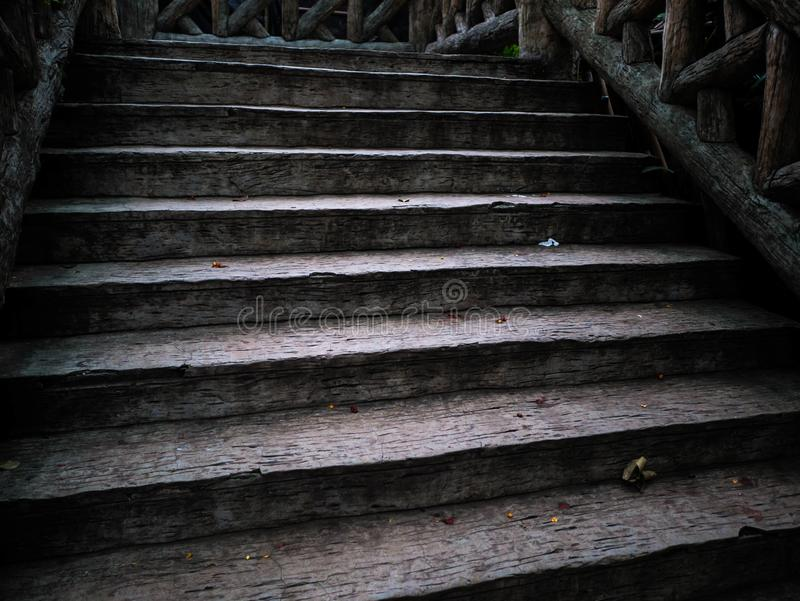 Old and ancient wooden ladder, dirty wood ladder royalty free stock image