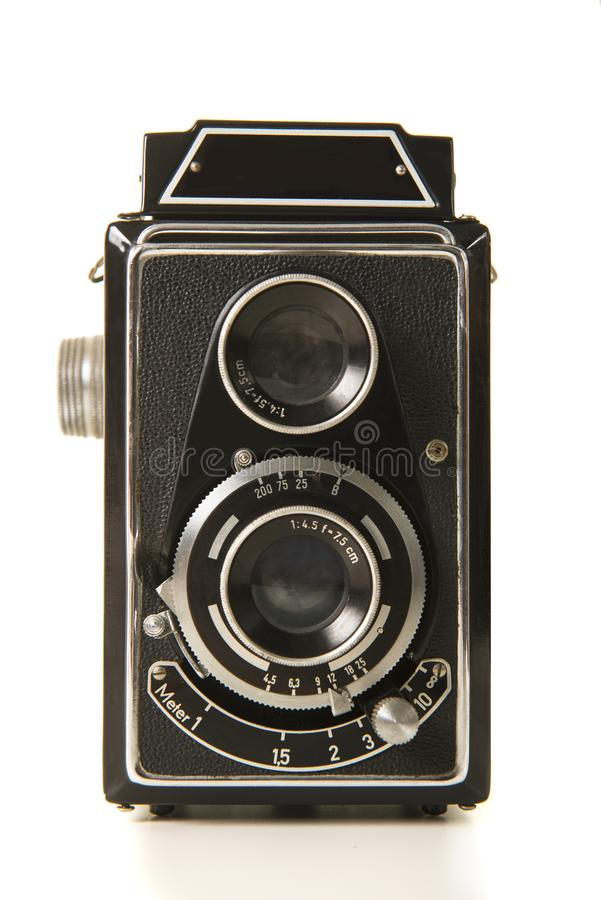 Old antique black photo camera on a white background. Old antique black photo camera isolated on a white background royalty free stock image