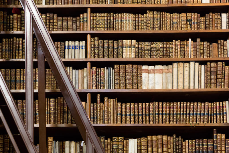 Old antique books. Library with collection in bookshelves royalty free stock images
