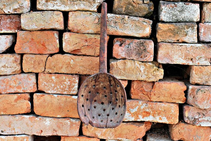 Old antique broken wood spoon with holes stock photo