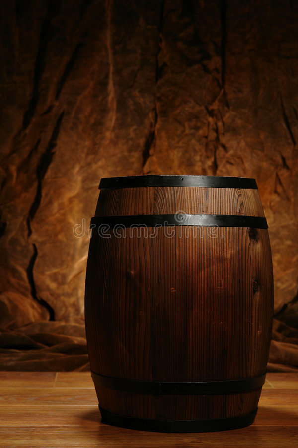 Old Antique Brown Wood Whisky or Wine Barrel Cask. Old fashioned antique whisky or wine wood barrel cask in nostalgic antique americana brown decor stock photos