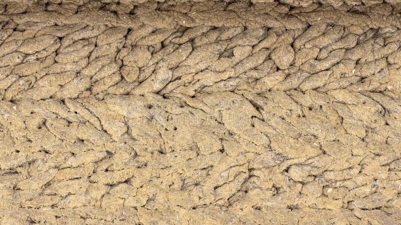 old antique clay wall, mud hut, cracked clay royalty free stock images