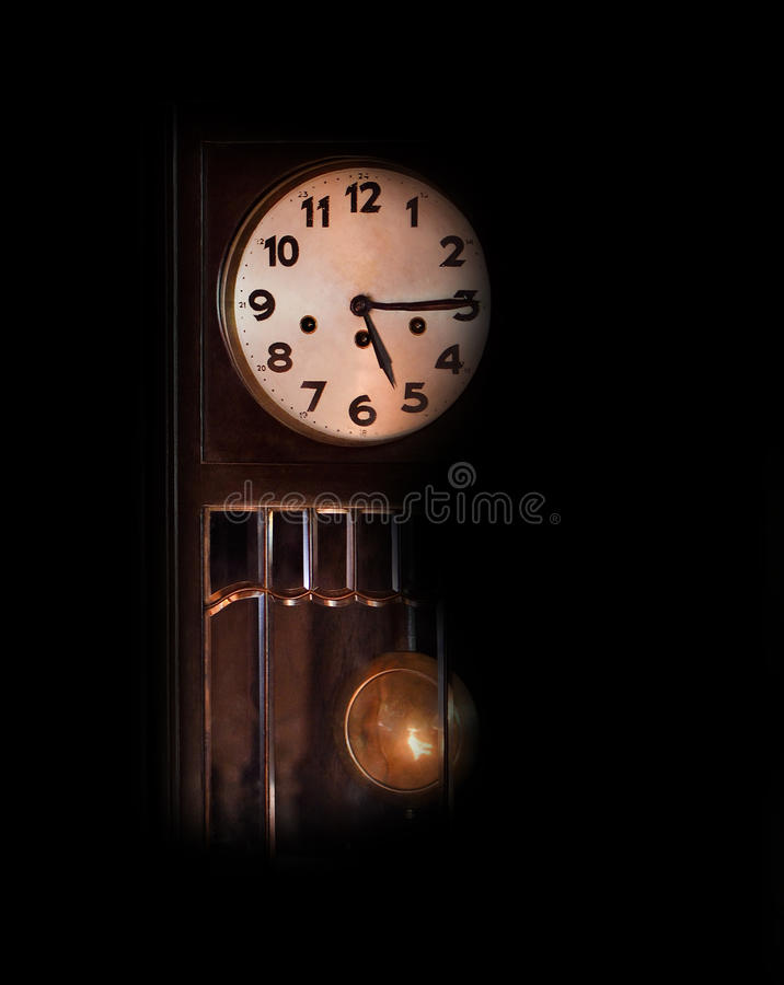 Old antique clock on a black background. Old antique clock on black background royalty free stock image