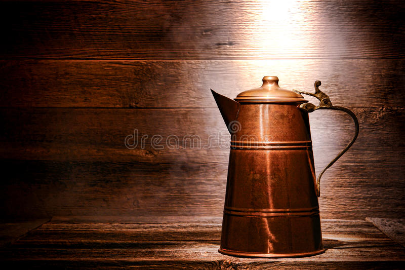 Old Antique Copper Water Pitcher in Ancient House stock image