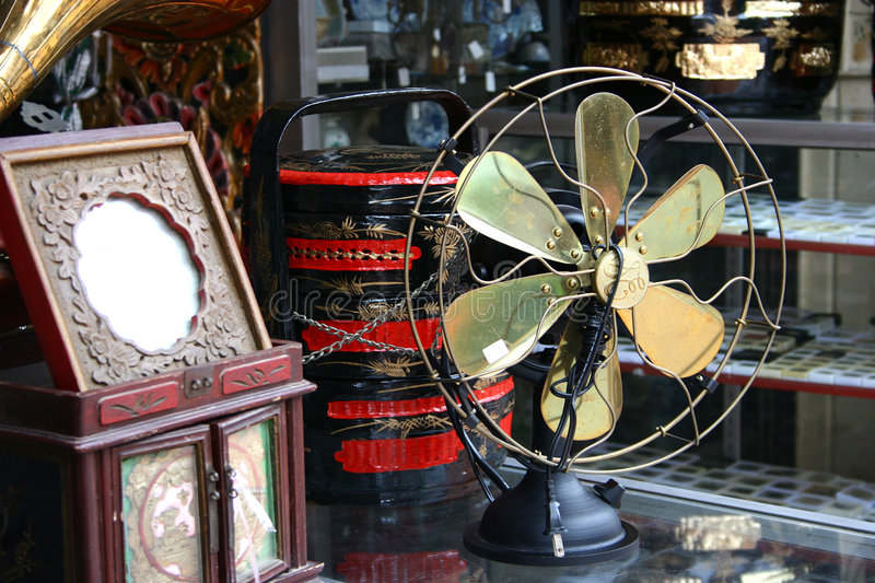 Old antique fan. In antique shop royalty free stock photography