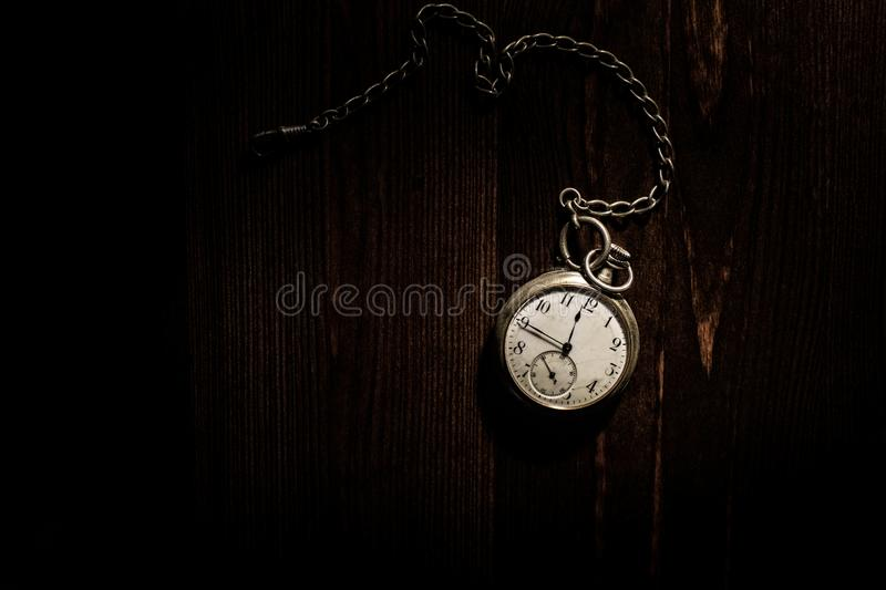 Old antique gold pocket watch with chain. Close up, open back concept. royalty free stock image