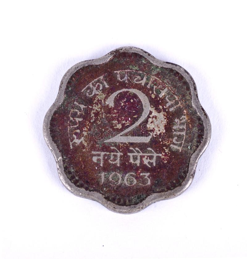 An old antique indian coin. An old antique indian two paise coin royalty free stock photography